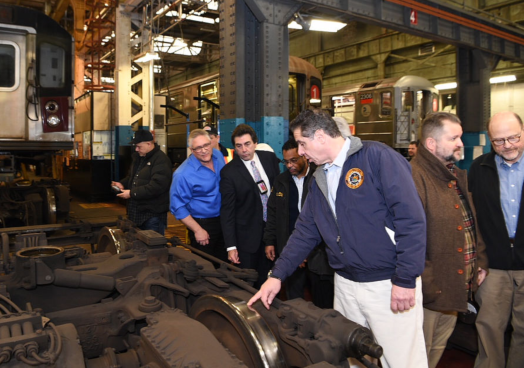 Governor Cuomo Tours Subway Repair Shop.png