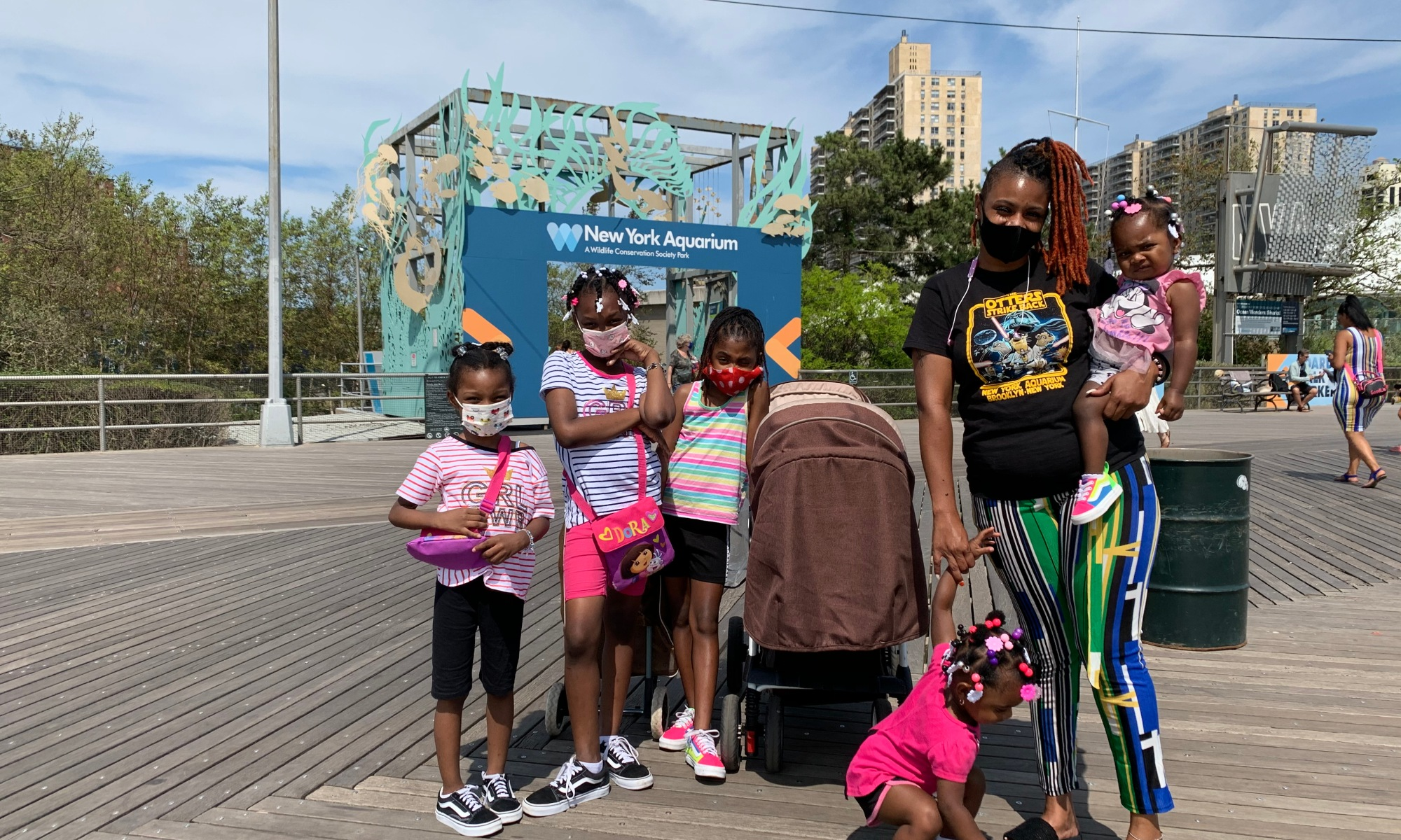 Brooklyn family at Coney Island wearing masks. Photo by ConsumerMojo.com